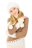 Muchacha adolescente en un casquillo y una bufanda aislados Imagen de archivo libre de regalías