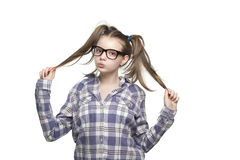 Muchacha adolescente en una camisa de tela escocesa Foto de archivo