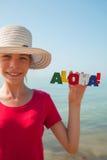 Muchacha adolescente en una playa Imagen de archivo libre de regalías