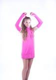 Muchacha adolescente en una presentación rosada de la alineada Fotos de archivo