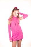 Muchacha adolescente en una presentación rosada de la alineada Imagen de archivo