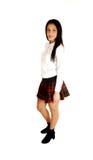 Muchacha adolescente en uniforme escolar. Fotografía de archivo