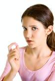 Muchacha adolescente encantadora con la píldora Imagen de archivo libre de regalías