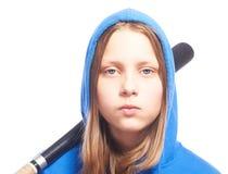 Muchacha adolescente enojada en capilla con el bate de béisbol Foto de archivo libre de regalías