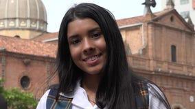 Muchacha adolescente feliz cerca de la iglesia Fotos de archivo libres de regalías