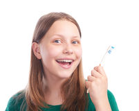 Muchacha adolescente feliz con el cepillo de dientes Imagenes de archivo