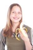 Muchacha adolescente feliz con el plátano Imágenes de archivo libres de regalías