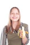 Muchacha adolescente feliz con el plátano Imagen de archivo libre de regalías