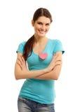 Muchacha adolescente feliz con la tarjeta del día de San Valentín del símbolo del amor del corazón Imágenes de archivo libres de regalías