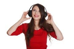 Muchacha adolescente feliz con los auriculares Imágenes de archivo libres de regalías