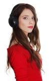 Muchacha adolescente feliz con los auriculares Imagenes de archivo