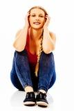 Muchacha adolescente feliz en el piso Fotografía de archivo libre de regalías