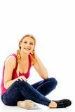 Muchacha adolescente feliz en el piso Imagen de archivo libre de regalías