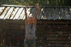 Muchacha adolescente feliz en la lluvia del verano Fotografía de archivo libre de regalías