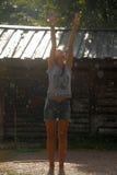 Muchacha adolescente feliz en la lluvia del verano Imágenes de archivo libres de regalías
