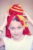 Muchacha adolescente feliz hermosa con la toalla en su cabeza Fotografía de archivo libre de regalías
