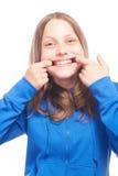 Muchacha adolescente feliz que hace caras divertidas Fotografía de archivo