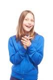 Muchacha adolescente feliz que hace caras divertidas Imagen de archivo libre de regalías