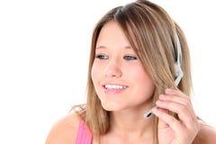 Muchacha adolescente hermosa con el receptor de cabeza sobre blanco Fotos de archivo