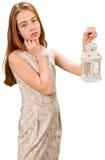 Muchacha adolescente hermosa con la linterna Imagen de archivo libre de regalías