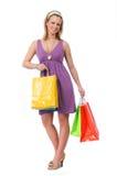 Muchacha adolescente hermosa con los bolsos de compras Foto de archivo libre de regalías