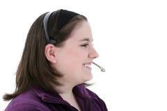 Muchacha adolescente hermosa con los Wi del teléfono directo o del cotilleo de la preparación del receptor de cabeza Imagen de archivo libre de regalías