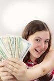 Muchacha adolescente hermosa que sostiene el dinero Fotografía de archivo