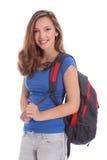 Muchacha adolescente joven sonriente de la escuela con el morral Imagenes de archivo