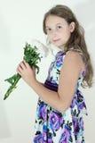 Muchacha adolescente linda con el ramo de flores Fotografía de archivo libre de regalías