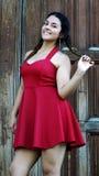 Muchacha adolescente linda en rojo Imagenes de archivo