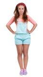 Muchacha adolescente pelirroja en pantalones cortos Imagen de archivo libre de regalías