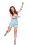 Muchacha adolescente pelirroja en pantalones cortos Fotos de archivo