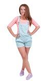 Muchacha adolescente pelirroja en pantalones cortos Fotos de archivo libres de regalías
