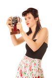 Muchacha adolescente preciosa con la cámara vieja Foto de archivo