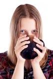Muchacha adolescente que bebe de la taza Imagen de archivo