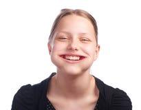 Muchacha adolescente que come la fresa Foto de archivo libre de regalías