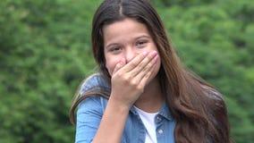 Muchacha adolescente que cubre su boca Fotos de archivo libres de regalías