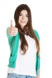 Muchacha adolescente que gesticula los pulgares para arriba Foto de archivo libre de regalías