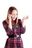 Muchacha adolescente que habla en el teléfono móvil y vuelta a enviar Foto de archivo