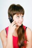 Muchacha adolescente que habla en un teléfono celular Imagen de archivo