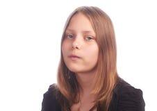 Muchacha adolescente que hace caras divertidas en el fondo blanco Imágenes de archivo libres de regalías