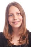 Muchacha adolescente que hace caras divertidas en el fondo blanco Foto de archivo