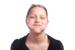Muchacha adolescente que hace caras divertidas en el fondo blanco Imagen de archivo libre de regalías