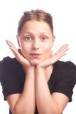 Muchacha adolescente que hace caras divertidas en el fondo blanco Fotografía de archivo libre de regalías