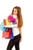 Muchacha adolescente que hace compras que sonríe con los bolsos Fotografía de archivo libre de regalías