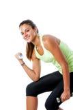 Muchacha adolescente que hace ejercicio del bíceps Fotos de archivo