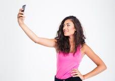 Muchacha adolescente que hace la foto del selfie en smartphone Imagen de archivo