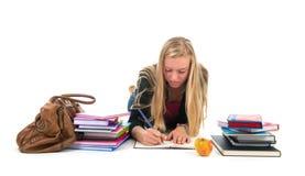 Muchacha adolescente que hace la preparación para la escuela Foto de archivo