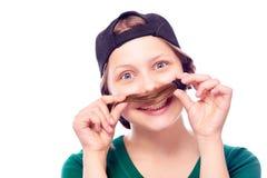 Muchacha adolescente que juega con su pelo Fotos de archivo