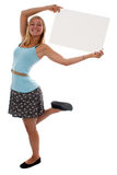 Muchacha adolescente que lleva a cabo una muestra en blanco Foto de archivo libre de regalías